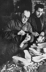 "<p>Jewish forced laborers at work making shoes in a <a href=""/narrative/286/en"">ghetto</a> workshop. <a href=""/narrative/3182/en"">Kovno</a>, Lithuania, December 1943.</p>"