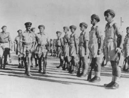 """<p>Brigadier Ernest Frank Benjamin, commanding officer of the <a href=""""/narrative/4750/en"""">Jewish Brigade</a>, inspects the Second Battalion. Palestine, October 1944.</p> <p>The Jewish Brigade Group of the British army, which fought under the Zionist flag, was formally established in September 1944. It included more than 5,000 Jewish volunteers from Palestine organized into three infantry battalions and several supporting units.</p>"""