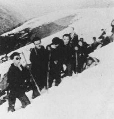 "<p>Jewish refugees from <a href=""/narrative/4997"">France</a> and the <a href=""/narrative/5566"">Netherlands</a> make their way from France into Spain through a pass in the Pyrenees mountain range. They are being rescued by ""Dutch-Paris,"" an organization created by Seventh-day Adventist <a href=""/narrative/7458"">Johan Weidner</a>. Ca. 1940.</p>"