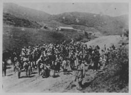 <p>Ottoman troops guard Armenians being deported. Ottoman Empire, 1915-16.</p>