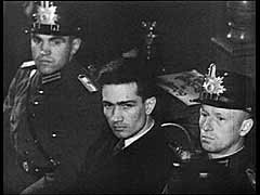 <p>On the night of February 27, 1933, an unemployed Dutch construction worker named Marinus van der Lubbe set fire to the Reichstag (German parliament) building, causing serious damage. The Nazis blamed the Communists for the fire and claimed emergency powers to crush all opposition. Bolstering Nazi claims, the police also arrested three Bulgarian members of the Communist International, who were in Germany at the time, and a leading German Communist. Despite Nazi claims, however, responsibility for the fire is unclear. The German Supreme Court found only van der Lubbe guilty. The Court acquitted the other defendants because there was insufficient evidence of their involvement. This footage shows scenes during the trial and some of the damage to the Reichstag building in Berlin.</p>