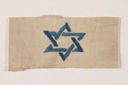 "<div class=""datapair"">In December 1939, German authorities required Jews residing in the Generalgouvernement (which included Krakow) to wear white armbands with blue Stars of David for purposes of identification.</div>