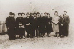 <p>November 1938 group portrait of Jews of Polish nationality who were expelled from Nuremberg, Germany, to the Polish border town of Zbaszyn.The Jewish refugees were stranded on the border and were denied admission into Poland aftertheir explusionfrom Germany.<br /><br />Pictured from left to right are: Leo Fallmann; Rosa Fallmann; Mr. Auerbach; Mr. Zahn; unknown; unknown; Chaim Kupfermann; Anni Kupfermann; Simon Wassermann; unknown; Regina Holzer; and Bertha Holzer.</p> <p></p>