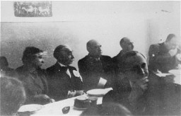 A meeting of the Warsaw Jewish council. Sitting behind table, 2nd to 4th from left: industrialist Abraham Gepner; chairman Adam Czerniakow; ... [LCID: 60545]