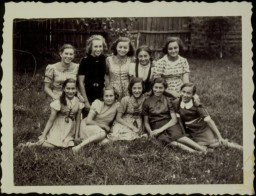 A group of young girls pose in a yard in the town of Eisiskes. The Jews of this shtetl were murdered by the Einsatzgruppen on September 21, 1941. Photo taken before September 1941.