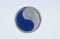 """<p>Insignia of the <a href=""""/narrative/8038"""">29th Infantry Division</a>. """"Blue and Gray"""" was coined as the nickname of the 29th Infantry Division by the division's commander during <a href=""""/narrative/28"""">World War I</a>. The name commemorates the lineage of the mid-Atlantic states' National Guard units that formed the division, many with service on both sides during the Civil War.</p>"""