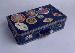 <p>A suitcase used (ca. 1939) by a Jewish refugee fleeing Nazi-occupied Europe to Japan. The suitcase is covered with labels from various stops along the journey, including one from a hotel in Moscow (top left), one for the NYK Line (top middle), and six from hotels throughout Japan. [From the USHMM special exhibition Flight and Rescue.]</p>