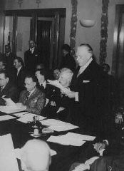 """<p>Myron Taylor, US delegate to the <a href=""""/narrative/6748"""">Evian Conference</a>, pleads for the establishment of an intergovernmental committee to facilitate Jewish emigration. Evian-les-Bains, France, July 15, 1938.</p>"""
