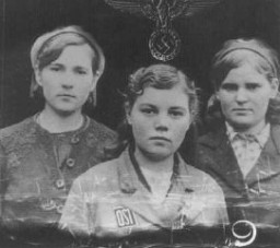 "<p>""Ostarbeiter"" (eastern workers) were mostly eastern European women brought to Germany for <a href=""/narrative/3384"">forced labor</a>. They wore an ""OST"" identification patch (lower center of photograph) Germany, after 1942.</p>"