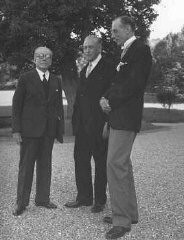 """<p>The <a href=""""/narrative/6748"""">Evian Conference</a> on Jewish <a href=""""/narrative/2419"""">refugees</a>. From left to right are French delegate Henri Berenger, United States delegate Myron Taylor, and British delegate Lord Winterton. France, July 8, 1938.</p>"""