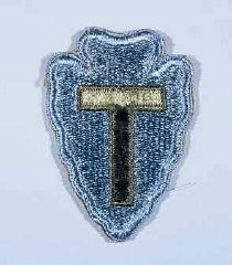 """<p>Insignia of the <a href=""""/narrative/8035"""">36th Infantry Division</a>. The 36th Infantry Division, the """"Texas"""" division, was raised from National Guard units from Texas and Oklahoma during <a href=""""/narrative/28"""">World War I</a>. The """"T"""" in the division's insignia represents Texas, the arrowhead Oklahoma. The division was also sometimes called the """"Lone Star"""" division, again symbolizing its Texas roots.</p>"""