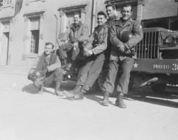 Group portrait of members of Combat Unit 123, a unit of the U.S. Army 167th Signal Photo Company: Walt MacDonald, Arnold Samuelson, J Malan Heslop, John O'Brien, and Eddie Urban.