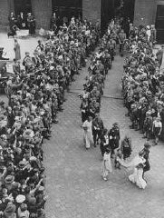 """<p>A mass marriage of 50 couples in Berlin. All of the couples belonged to the <a href=""""/narrative/61038"""">Nazi Party</a>. Berlin, Germany, July 2, 1933.</p>"""