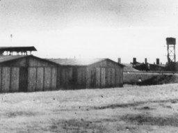 "<p>View of the <a href=""/narrative/10797/en"">Trawniki</a> training camp showing two barracks and a watch tower. Trawniki, Poland, between 1941 and 1944. </p>"