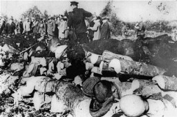 "<p>Corpses of inmates discovered by Soviet troops at the Klooga forced-labor camp. Nazi guards and Estonian collaborators had executed the prisoners and then stacked the bodies for burning. <a href=""/narrative/5858/en"">Estonia</a>, September 1944.</p>"