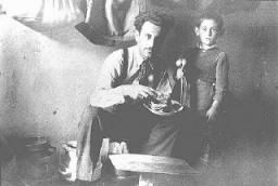 <p>Mr. Mandil and his son Gavra, Yugoslav Jews, while in hiding. The Mandil family escaped to Albania in 1942. After the German occupation in 1943, Mandil's Albanian apprentice hid the family, all of whom survived. Albania, between 1942 and 1945.</p>