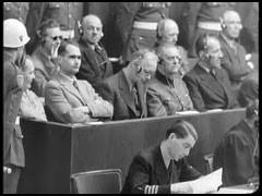 Defendant Hermann Göring listens to trial testimony