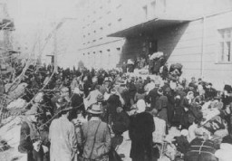 """<p>Deportation of Jews from Skopje, Yugoslavia, March 1943.</p> <p>The Jews of <a href=""""/narrative/5955/en"""">Bulgarian-occupied</a> Thrace and Macedonia were deported in March 1943.On March 11, 1943, over 7,000 Macedonian Jews from Skopje, Bitola, and Stip were rounded up and assembled at the Tobacco Monopoly in Skopje, whose several buildings had been hastily converted into a transit camp. The Macedonian Jews were kept there between eleven and eighteen days, before being deported by train in three transports between March 22 and 29, to Treblinka.</p>"""