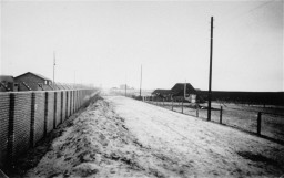 """<p>View of the wall enclosing the <a href=""""/narrative/63644"""">Esterwegen</a> concentration camp, 1936.</p>"""