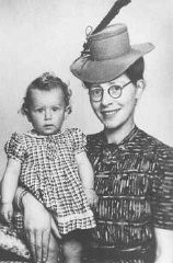 "<p>Semmy Woortman-Glasoog with Lientje, a 9-month-old Jewish girl she hid. Woortman-Glasoog was active in a network which found foster homes, hiding places, and false papers for Jewish children. She was later named ""<a href=""/narrative/11778"">Righteous Among the Nations</a>."" Amsterdam, the Netherlands, between 1942 and 1944.</p>"