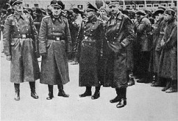 "<p>SS officers posing in front of a newly arrived transport of <a href=""/narrative/10135/en"">Soviet prisoners of war</a>. Mauthausen concentration camp, Austria, 1941.</p>"