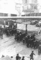 "<p>Deportation of Jews from the Warsaw ghetto during the <a href=""/narrative/3636/en"">uprising</a>. This photo was taken secretly from a building adjacent to the ghetto by a Polish member of the resistance. Warsaw, Poland, April 1943.</p>"