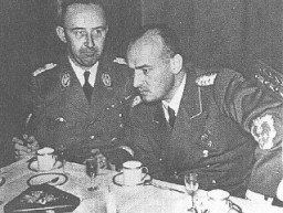 "<p>SS chief <a href=""/narrative/10813/en"">Heinrich Himmler</a> (left) and Hans Frank, head of the Generalgouvernement in occupied Poland. Krakow, Poland, 1943.</p>"