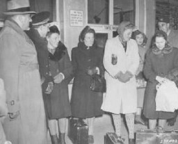 "<p>Four Polish women arrive at the Nuremberg train station to serve as prosecution witnesses at the <a href=""/narrative/9245/en"">Doctors Trial</a>. From left to right are <a href=""/narrative/3045/en"">Jadwiga Dzido</a>, Maria Broel-Plater, Maria Kusmierczuk, and <a href=""/narrative/3043/en"">Wladislawa Karolewska</a>. December 15, 1946.</p>"