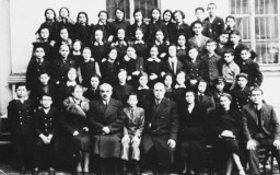 Group portrait of the first grade class of the Jewish gymnasium in Vilna. 1938