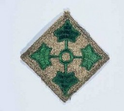 "<p>Insignia of the <a href=""/narrative/7804/en"">4th Infantry Division</a>. The 4th Infantry Division's nickname, the ""Ivy"" division, is derived from the divisional insignia developed during <a href=""/narrative/28/en"">World War I</a>: four ivy leaves on a diamond field, symbolizing the roman numeral ""IV.""</p>"