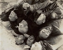 <p>Close-up of corpses piled in the crematorium mortuary in the newly liberated Dachau concentration camp. Dachau, Germany, May 1945.</p>