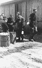 "<p>Prisoners receive meager food allocations at the <a href=""/narrative/4880/en"">Plaszow</a> camp. Krakow, Poland, 1943 or 1944.</p>"