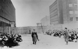 An assembly point (the Umschlagplatz) in the Warsaw ghetto for Jews awaiting deportation. Warsaw, Poland, between 1940 and 1943.