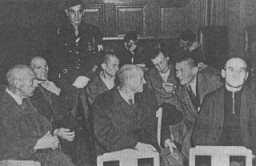 "<p>Staff from the <a href=""/narrative/8116"">Hadamar</a> euthanasia center, including senior physician Adolf Wahlmann (front, left), during their trial. Wiesbaden, Germany, October 8-15, 1945.</p>"