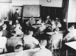 <p>German adults attend a class in racial theory. Germany, date uncertain.</p>