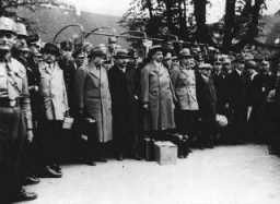 "<p>Under SA guard, a group of leading Socialists arrives at the Kislau camp, one of the <a href=""/narrative/4656/en"">early concentration camps</a>. Local Social Democratic party leader Ludwig Marum is fourth from the left in the line of arrivals. Kislau, Germany, May 16, 1933.</p>"