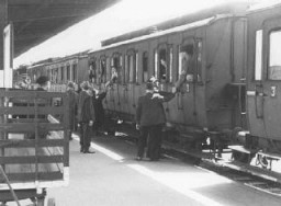 """<p>Departure of a train of German Jews being deported to <a href=""""/narrative/11041/en"""">Theresienstadt</a>. Hanau, Germany, May 30, 1942.</p>"""