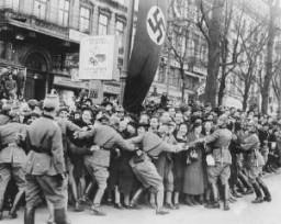 "<p>A cheering crowd greets Adolf Hitler as he enters <a href=""/narrative/6000/en"">Vienna</a>. Austria, March 1938.</p>