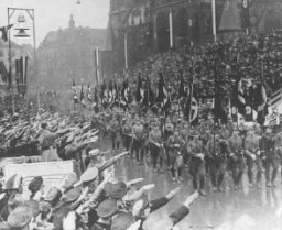 <p>Hitler reviews a parade celebrating the reintegration of the Saar region into Germany. Saar territory, Germany, March 1935.</p>