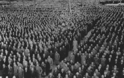 "<p>Roll call for newly arrived prisoners, mostly Jews arrested during <a href=""/narrative/4063""><em>Kristallnacht</em></a> (the ""Night of Broken Glass"" pogrom), at the Buchenwald concentration camp. Buchenwald, Germany, 1938.</p>"
