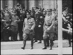 <p>In 1936, Germany and Italy signed a military alliance. The two powers formed the so-called Berlin-Rome Axis. This footage shows Italian Fascist leader Benito Mussolini's state visit to Germany in September 1937. He met with Hitler in Munich and the two leaders also toured other parts of Germany. During the state visit, Mussolini attended a military parade in Berlin, Germany's capital. Although both dictators declared their desire for peace, Germany would begin World War II in 1939. Italy would then enter the war as Germany's ally against Britain and France.</p>