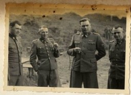Left to right: Dr. Josef Mengele, Rudolf Höss, Josef Kramer, and an unidentified officer. [LCID: 34755]