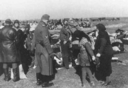 <p>Ukrainian Jews who were forced to undress before they were massacred by Einsatzgruppe detachments. This photo, originally in color, was part of a series taken by a German military photographer. Copies from this collection were later used as evidence in war crimes trials. Lubny, Soviet Union, October 16, 1941.</p>
