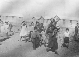 <p>Romani (Gypsy) women and children interned in the Rivesaltes transit camp. France, spring 1942.</p>