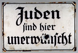 "<p>Signs excluding Jews, such as the sign shown here, were posted in public places (including parks, theaters, movie houses, and restaurants) throughout Nazi Germany. This sign states in German: ""Jews are not wanted here.""</p>"