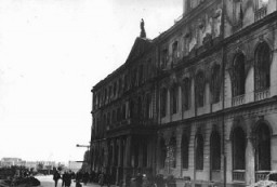 <p>German forces occupied Riga in early July 1941. Here, war damage to Riga's city hall is shown by blackened areas around the building's windows. Riga, Latvia, August 1941.</p>