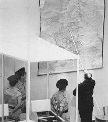 "<p><a href=""/narrative/3359/en"">Defendant Adolf Eichmann</a> identifies the city of <a href=""/narrative/5616/en"">Danzig</a> (Gdansk) on a map during his trial in Jerusalem. Israel, July 18, 1961.</p>"