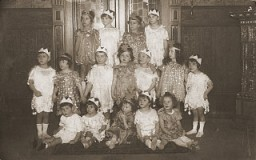 "<p>Group portrait of children dressed in <a href=""/narrative/9164/en"">Purim</a> costumes. Danzig, 1930-1939.</p>"