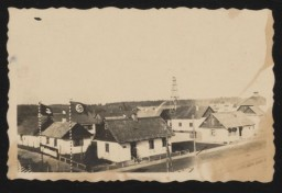"<p><span style=""font-weight: 400;"">View of the German personnel living quarters at the Sobibor <a href=""/narrative/2746"">killing center</a> entrance. This photograph was taken in the spring of 1943, from the watchtower at the camp's entrance. </span></p>