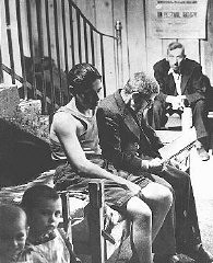 """<p>A man and his son, displaced persons (DPs) from Romania, wait on a cot in the Rothschild Hospital <a href=""""/narrative/6365"""">displaced persons camp</a> in Vienna. Austria, October 15, 1947.</p>"""
